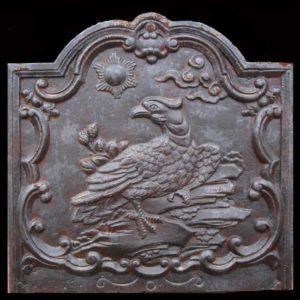 Piastra in ghisa per camino raffigurante uccello rapace