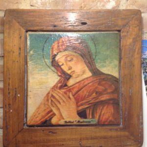 Madonna in cotto su cornice in legno
